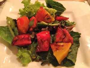 Organic salad with heirloom tomatoes and homemade balsamic dressing